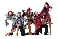 舞蹈家队佩带的狂欢节打扮跳舞 库存照片