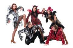 舞蹈家队佩带的狂欢节打扮跳舞 免版税图库摄影