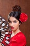 舞蹈演员佛拉明柯舞曲吉普赛女孩红色玫瑰色西班牙 图库摄影