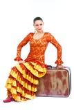 舞蹈演员佛拉明柯舞曲老坐的手提箱 免版税库存照片