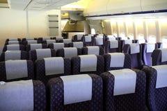 航空器内部乘客 免版税库存图片