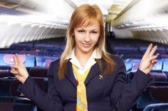 航空白肤金发的女招待空中小姐 库存图片