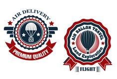 航空邮寄和热空气气球徽章 免版税库存照片
