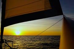 航行日落海洋 库存照片