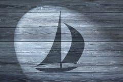 航行风船木头背景 免版税库存图片