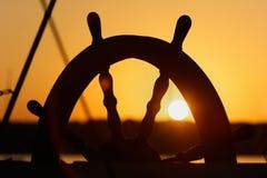 船在日落背景的` s轮子 免版税图库摄影