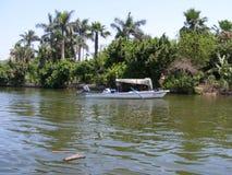 船的人们在河尼罗开罗 库存图片
