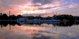 船舶小游艇船坞日出海景 澳洲 库存图片