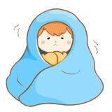 艰苦发抖在毯子下的不适的男孩 库存图片