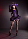 紫色万圣夜服装的性感的巫婆 免版税库存图片