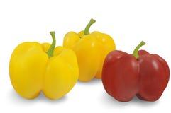 黄色三在白色背景隔绝的胡椒和红色 免版税库存照片