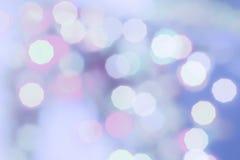 紫色上色了圣诞节bokeh光摘要假日背景 免版税库存图片