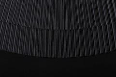 黑色与空的地方的被打褶的织品 库存图片