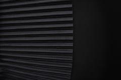 黑色与空的地方的被打褶的织品 免版税库存照片