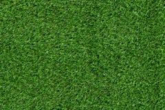 绿色人为草纹理地面橄榄球 免版税库存照片