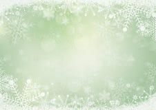 绿色冬天雪假日纸背景 库存图片