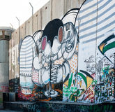 以色列人约旦河西岸障碍街道画 库存照片