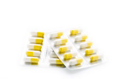 黄色压缩药片天线罩包装 库存照片