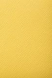 黄色压花革纹理背景 免版税库存照片