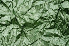 绿色发光的金属纸纹理背景 库存图片