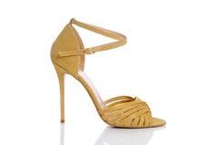 黄色发光的鞋子 免版税库存照片