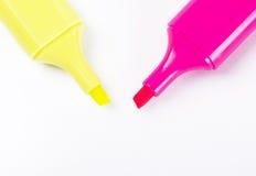 黄色和桃红色聚焦笔 免版税库存照片
