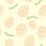 黄色和橙色无缝的样式用复活节装饰鸡蛋 库存图片