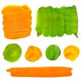 绿色和橙色树胶水彩画颜料油漆弄脏和冲程 免版税库存图片