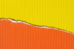 黄色和橙色被撕毁的纸背景纹理 免版税图库摄影
