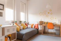 黄色和橙色辅助部件 免版税库存图片