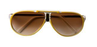 黄色和白色为装边的嬉戏太阳镜 免版税库存图片