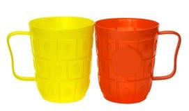 黄色和红色塑料玻璃 库存照片