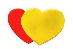 黄色和红色心脏由泡沫制成 免版税库存照片