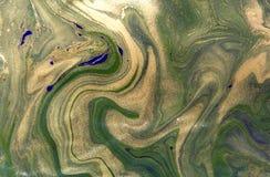 绿色和金使有大理石花纹的背景 免版税图库摄影