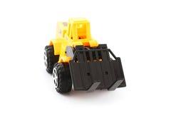 黄色和黑玩具铲车 免版税库存照片