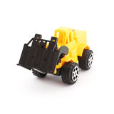 黄色和黑玩具铲车 库存照片