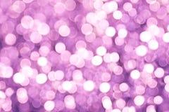 紫色和紫罗兰色轻的Bokeh背景 库存图片