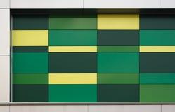 绿色和黄色大厦背景 免版税库存图片