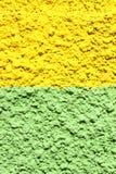 绿色和黄色混凝土墙 免版税库存图片