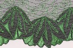 绿色和balck的宏观射击开花鞋带纹理材料 库存图片