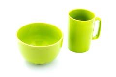绿色咖啡杯和绿色碗 免版税库存图片