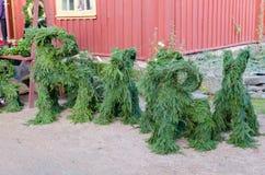 绿色圣诞节山羊由杉木分支做成 库存照片