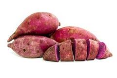 紫色在白色背景的色的白薯 图库摄影