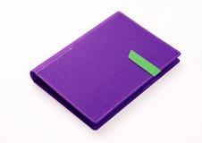 紫色在白色背景的色的组织者书 免版税库存图片