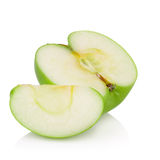 绿色在白色背景苹果隔绝的苹果和一半 免版税库存照片