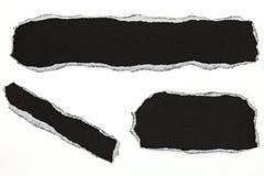 黑色在白色背景隔绝的被撕毁的纸 免版税库存图片
