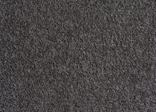 黑色地毯纹理 库存照片