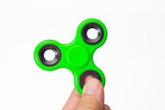绿色坐立不安手指锭床工人玩具图象 免版税库存图片