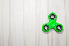 绿色坐立不安手指锭床工人玩具图象 库存照片