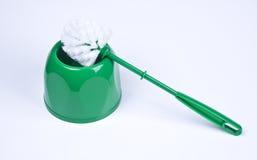 绿色塑料洗手间刷子 免版税库存图片